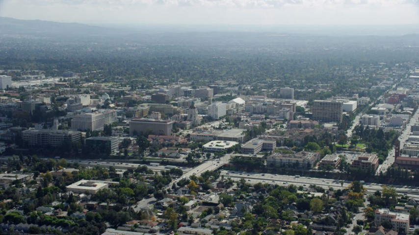8K stock footage aerial video of Pasadena City Hall and office buildings across the 134 freeway, Pasadena, California Aerial Stock Footage | AX0159_101