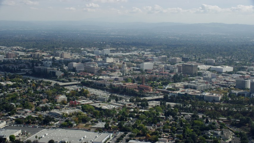 8K stock footage aerial video flying by Pasadena City Hall, office buildings, and 134 freeway, Pasadena, California Aerial Stock Footage | AX0159_102