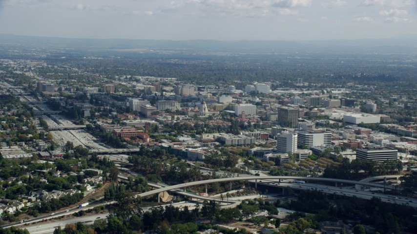 8K stock footage aerial video of Pasadena City Hall and office buildings across the 134 freeway, Pasadena, California Aerial Stock Footage | AX0159_103