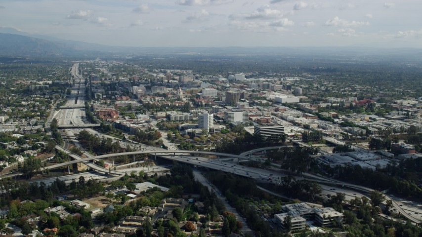 8K stock footage aerial video approaching the 134 freeway, office buildings, and Pasadena City Hall in California Aerial Stock Footage | AX0159_104