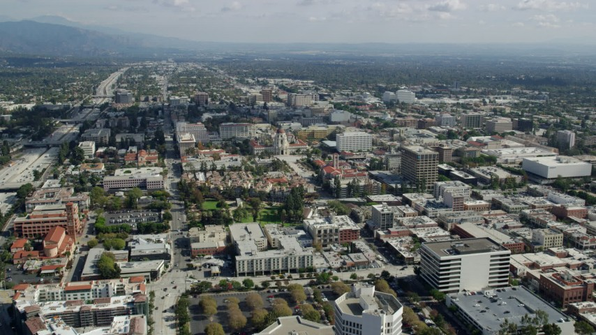 8K stock footage aerial video flying over an office building to approach Pasadena City Hall, California Aerial Stock Footage | AX0159_105