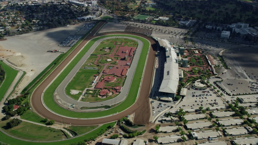 8K stock footage aerial video approaching and flying over the Santa Anita Park horse racing track in Arcadia, California Aerial Stock Footage | AX0159_113
