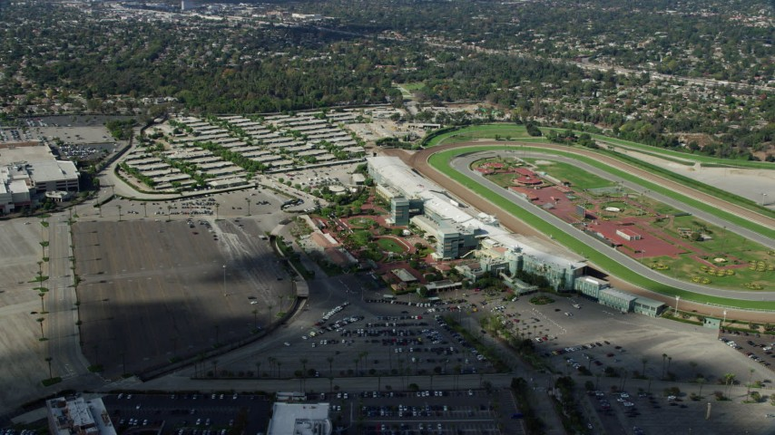 8K stock footage aerial video orbiting the Santa Anita Park horse race track and parking lot in Arcadia, California Aerial Stock Footage | AX0159_115