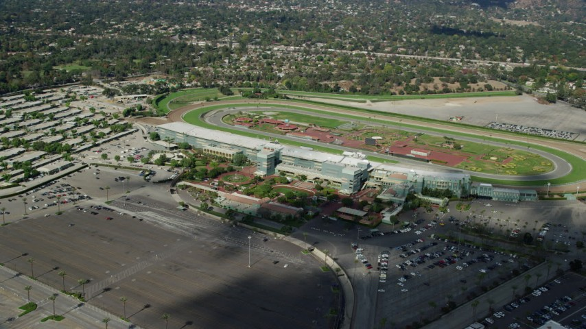 8K stock footage aerial video orbiting the Santa Anita Park horse racing track in Arcadia, California Aerial Stock Footage | AX0159_116