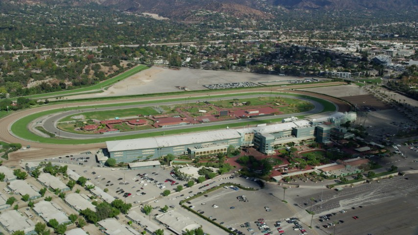 8K stock footage aerial video orbiting the Santa Anita Park horse racing track in Arcadia, California Aerial Stock Footage | AX0159_117