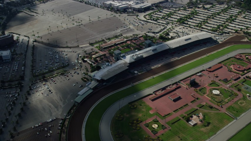 8K stock footage aerial video flying by and away from Santa Anita Park horse race track in Arcadia, California Aerial Stock Footage | AX0159_118