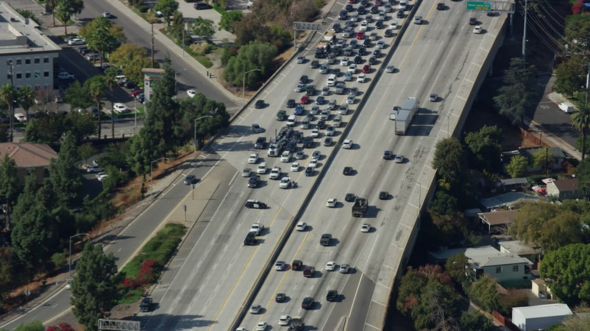 8K stock footage aerial video of traffic stopped by CHP on the 210 Freeway in Arcadia, California Aerial Stock Footage | AX0159_120