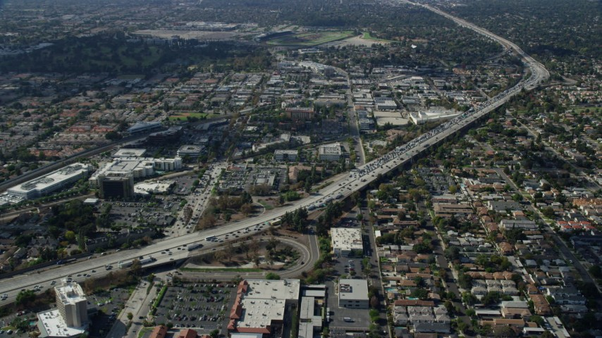 8K stock footage aerial video of a reverse view of traffic stopped by CHP on 210 Freeway in Arcadia, California Aerial Stock Footage | AX0159_121
