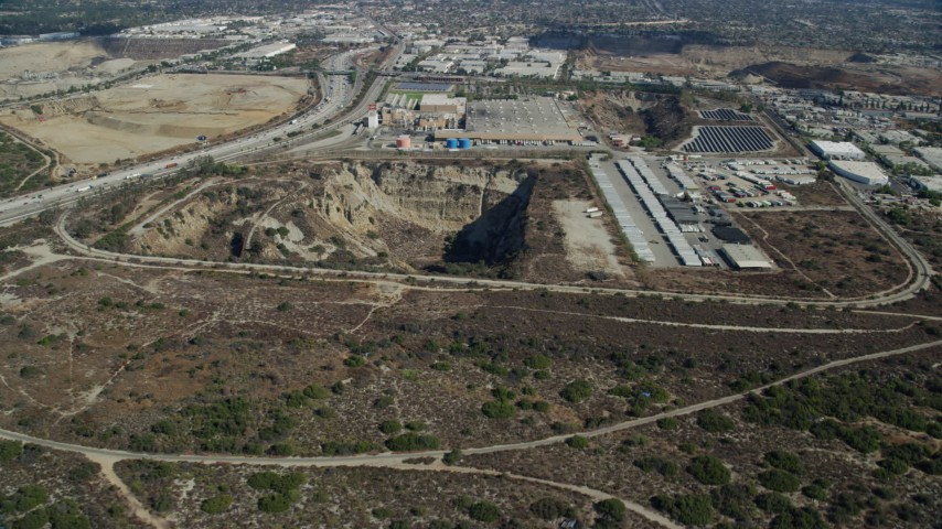 8K stock footage aerial video of an open pit next to a brewery in Irwindale, California Aerial Stock Footage | AX0159_125