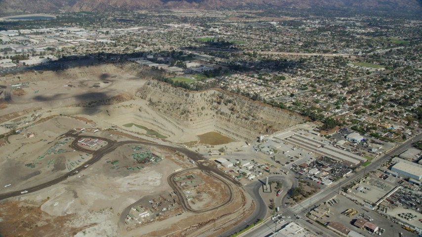 8K stock footage aerial video flying by a large gravel quarry in Irwindale, California Aerial Stock Footage | AX0159_127