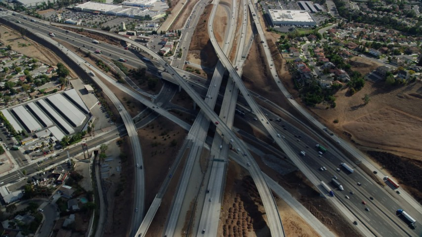 8K aerial video approaching and tilt to light traffic on the Hwy 60 & Hwy 71 Interchange in Pamona, California Aerial Stock Footage | AX0159_135
