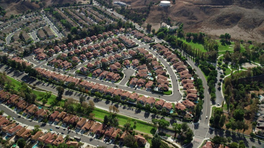 8K stock footage aerial video approaching and tilt to tract homes in Corona, California Aerial Stock Footage AX0159_153 | Axiom Images