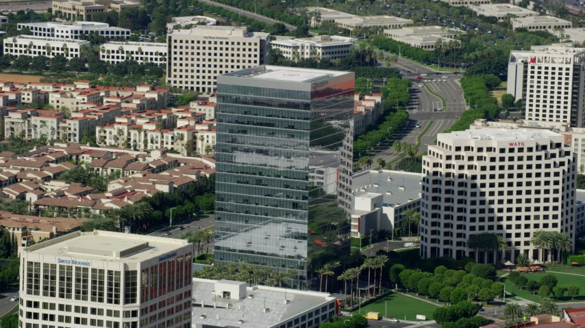 8K stock footage aerial video orbiting an office building at Irvine Spectrum Center Irvine, California Aerial Stock Footage | AX0159_170