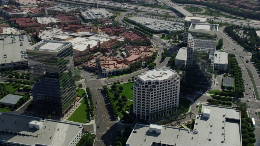 8K aerial video orbiting office buildings next to a shopping mall, Irvine, California Aerial Stock Footage | AX0159_173