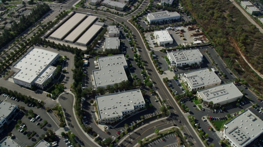 8K stock footage aerial video flying over and orbit office buildings in a business park, Irvine, California Aerial Stock Footage | AX0159_176