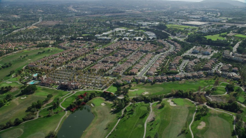 8K stock footage aerial video flying over golf course and tract homes, Aliso Viejo, California Aerial Stock Footage | AX0159_177