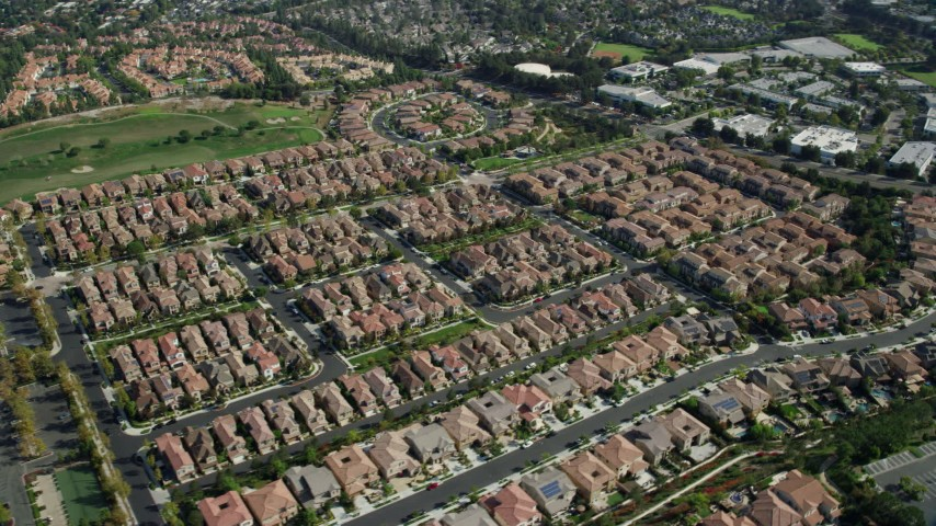 8K stock footage aerial video orbiting a neighborhood of tract homes, Aliso Viejo, California Aerial Stock Footage | AX0159_178