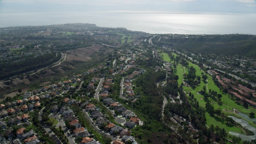 8K aerial video of El Niguel Country Club and neighborhoods near the coast in Laguna Niguel, California Aerial Stock Footage | AX0159_184