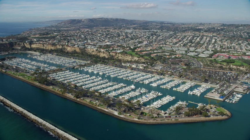 8K stock footage aerial video of Dana Point Harbor and seaside neighborhoods in Dana Point, California Aerial Stock Footage | AX0159_189