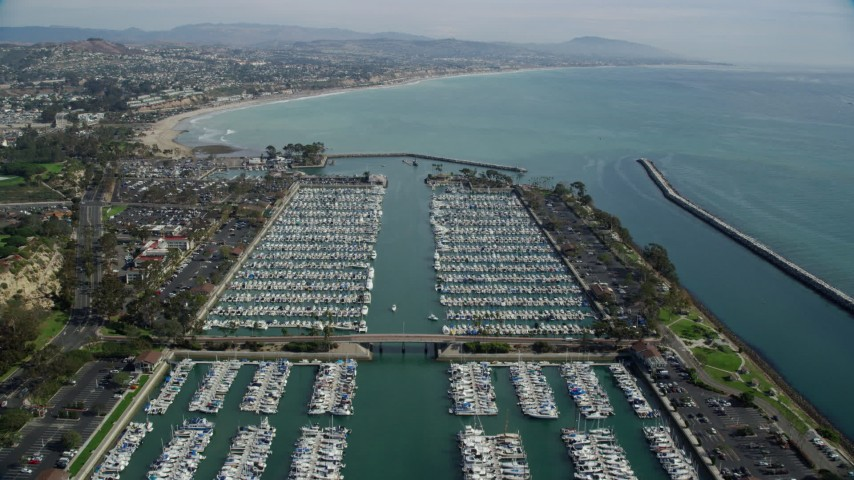 8K stock footage aerial video flying over boats docked at Dana Point Harbor in Dana Point, California Aerial Stock Footage | AX0159_193