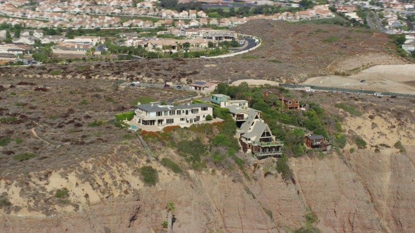 8K stock footage aerial video of clifftop mansions and Dana Point Nature Interpretive Center in Dana Point, California Aerial Stock Footage | AX0159_199