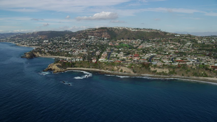 8K aerial video flying by homes around Three Arch Bay Beach in Laguna Beach, California Aerial Stock Footage | AX0159_202
