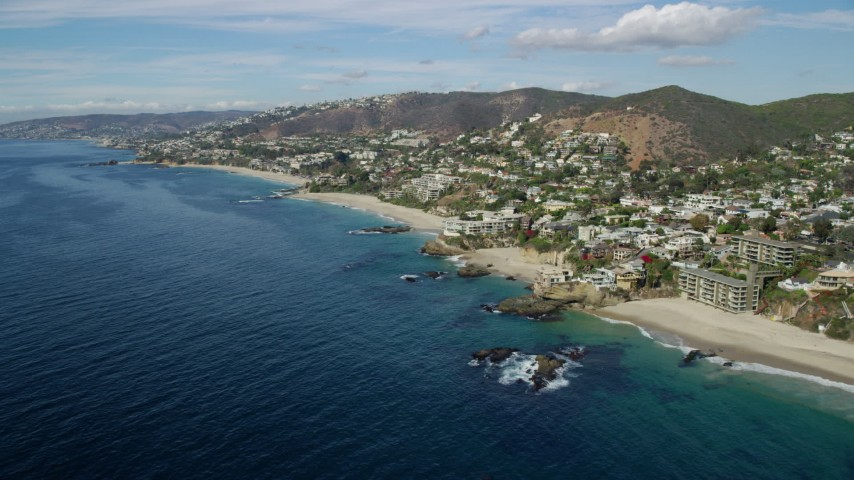 8K aerial video of oceanfront homes beside Table Rock Beach, West Street Beach in Laguna Beach, California Aerial Stock Footage | AX0159_205