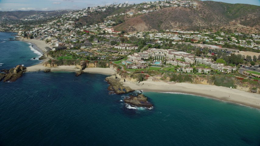8K stock footage aerial video of Treasure Island Beach and Montage Laguna Beach hotel in Laguna Beach, California Aerial Stock Footage | AX0159_207