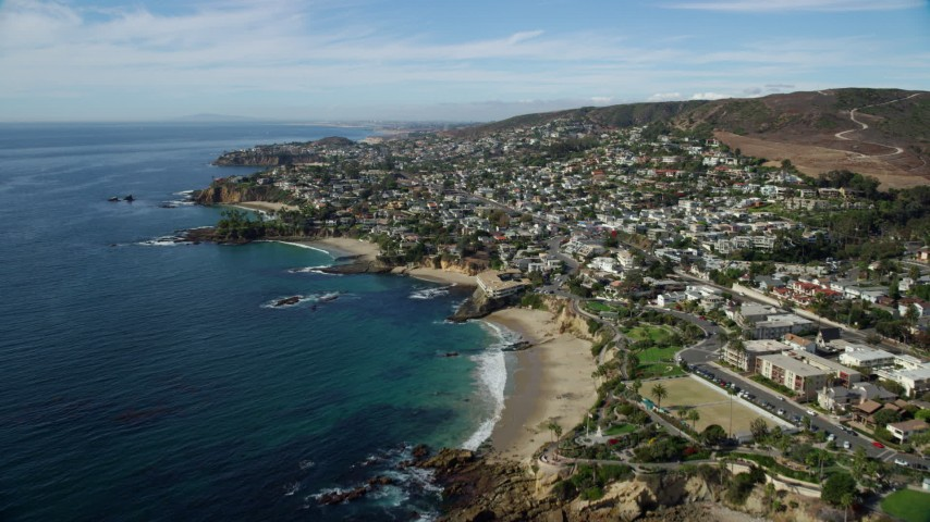 8K aerial video flying over coastline and Heisler Park, Recreation Point, Diver's Cove, Laguna Beach, California Aerial Stock Footage | AX0159_223