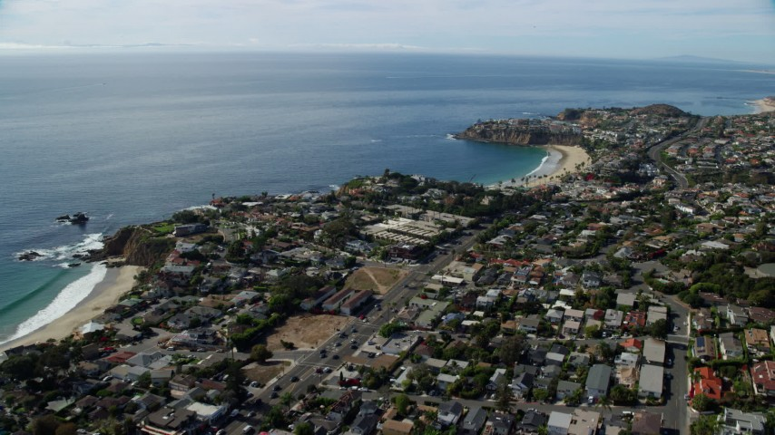 8K stock footage aerial video flying over coastal highway and houses, Laguna Beach, California Aerial Stock Footage | AX0159_224
