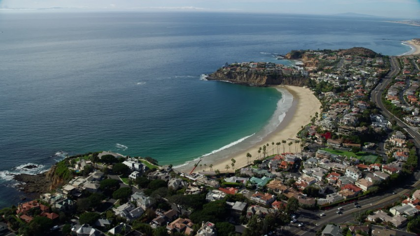 8K aerial video flying over homes toward Emerald Bay, Laguna Beach, California Aerial Stock Footage | AX0159_225
