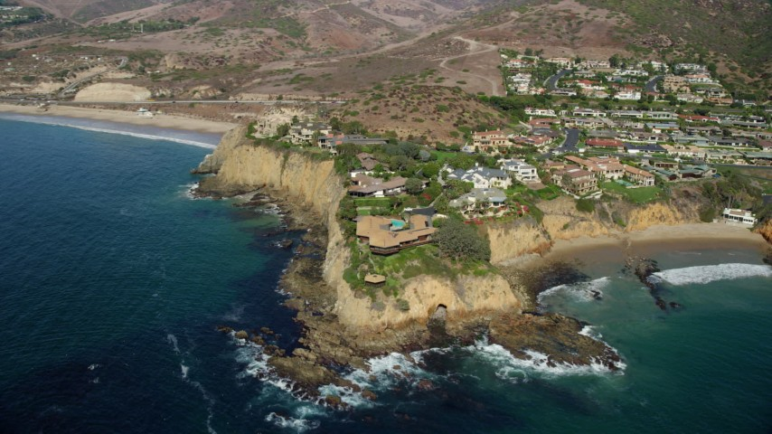 8K stock footage aerial video orbiting houses on Abalone Point, Laguna Beach, California Aerial Stock Footage | AX0159_227
