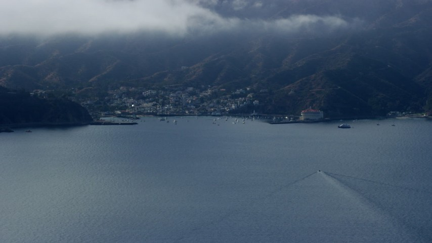 8K stock footage aerial video approaching the harbor and the island town of Avalon, Catalina Island, California Aerial Stock Footage | AX0159_245