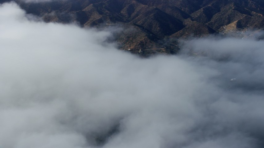 8K stock footage aerial video of low clouds over Avalon, Catalina Island, California Aerial Stock Footage | AX0159_249