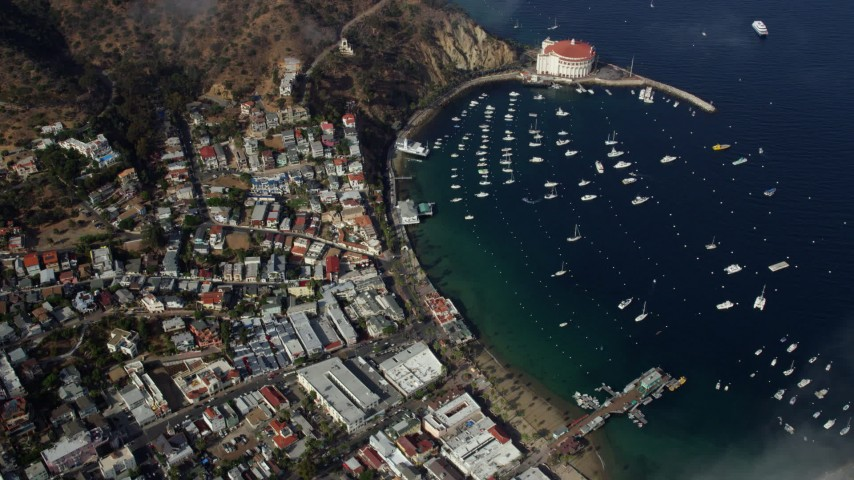 8K stock footage aerial video flying over clouds to reveal Avalon, Catalina Island, California Aerial Stock Footage AX0159_251 | Axiom Images