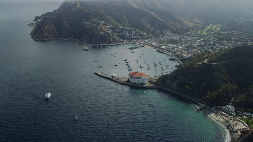 8K stock footage aerial video of the harbor and coastal town of Avalon, Catalina Island, California Aerial Stock Footage | AX0159_254