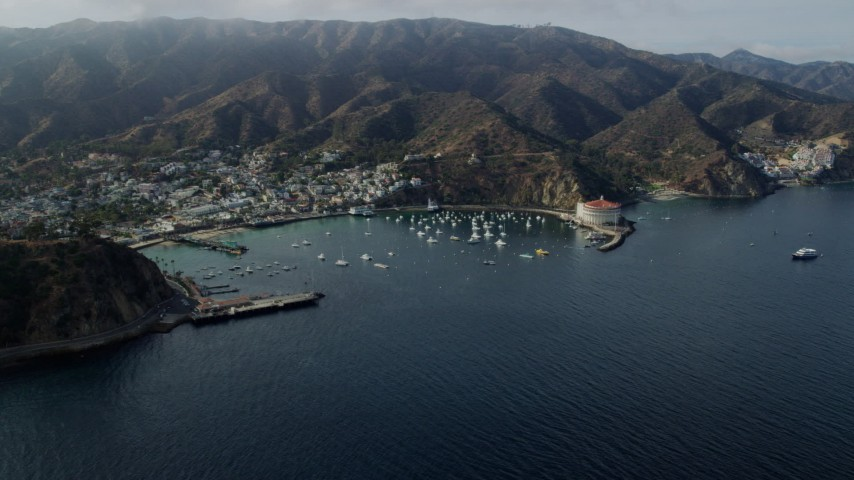 8K stock footage aerial video of the island town of Avalon and Avalon Bay on Catalina Island, California Aerial Stock Footage | AX0159_258
