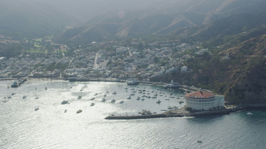 8K stock footage aerial video of boats in Avalon Bay harbor by the island town on Santa Catalina Island, California Aerial Stock Footage | AX0159_264