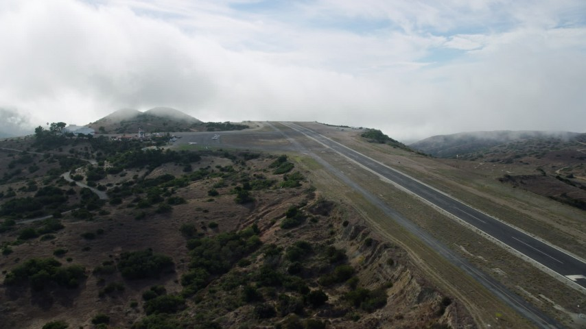 8K stock footage aerial video approaching the Catalina Airport runway on Santa Catalina Island, California Aerial Stock Footage | AX0159_272