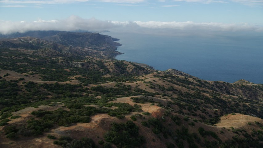 8K stock footage aerial video flying over hills toward the coast of Santa Catalina Island, California Aerial Stock Footage | AX0160_001