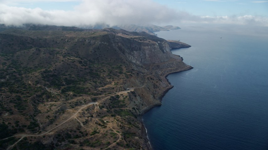 8K stock footage aerial video approaching steep coastal cliffs on Santa Catalina Island, California Aerial Stock Footage | AX0160_004
