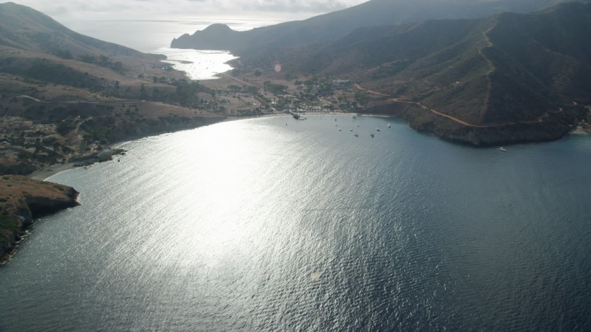 Flyby the Two Harbors island community on Santa Catalina Island, California Aerial Stock Footage | AX0160_008