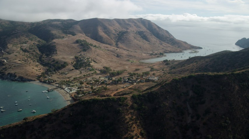 8K stock footage aerial video of a reverse view of the Two Harbors island community in Santa Catalina Island, California Aerial Stock Footage | AX0160_010