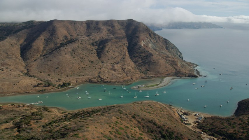 8K stock footage aerial video of sailboats in Catalina Harbor in Two Harbors, Santa Catalina Island, California Aerial Stock Footage | AX0160_013
