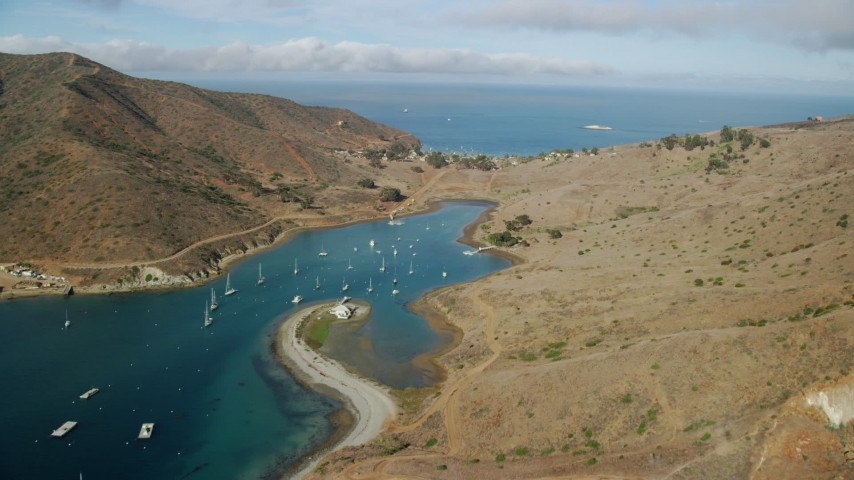 8K stock footage aerial video flying by Catalina Harbor to approach the island town of Two Harbors, Santa Catalina Island, California Aerial Stock Footage | AX0160_016