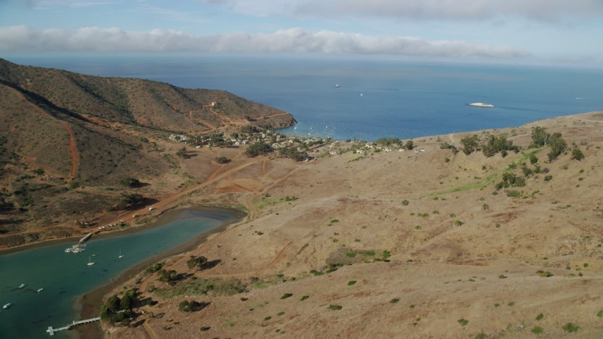 8K stock footage aerial video flying by Catalina Harbor and the Two Harbors island community on Santa Catalina Island, California Aerial Stock Footage | AX0160_017