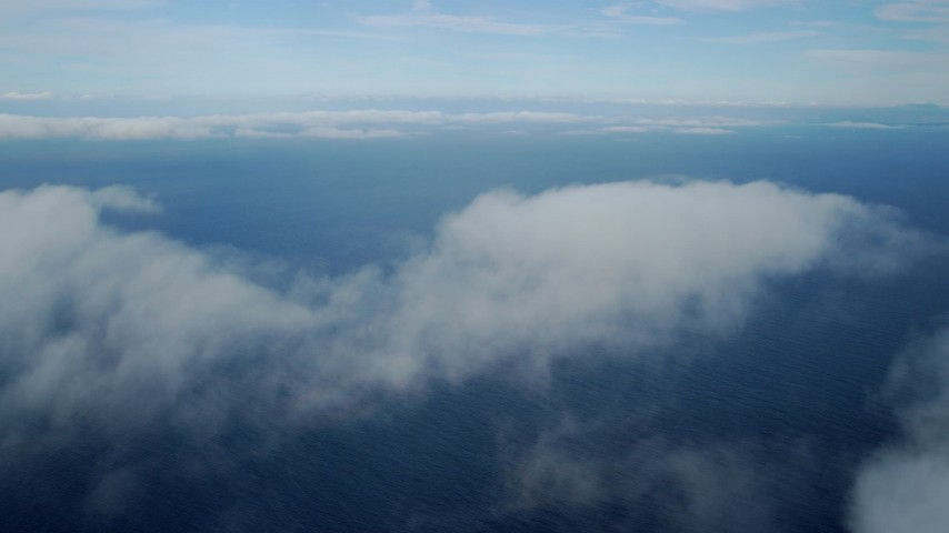 8K stock footage aerial video flying over low level clouds over the Pacific Ocean off the coast of Southern California Aerial Stock Footage | AX0160_022