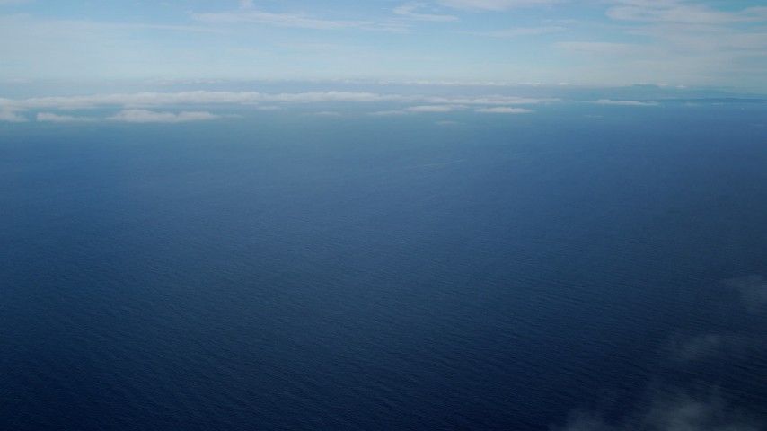 8K stock footage aerial video of low level clouds and open water in the Pacific Ocean off the coast of Southern California Aerial Stock Footage | AX0160_023