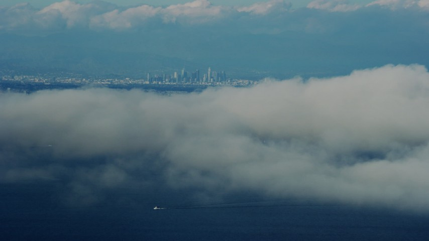 8K stock footage aerial video of Downtown Los Angeles skyline seen from Catalina Island, California Aerial Stock Footage | AX0160_025
