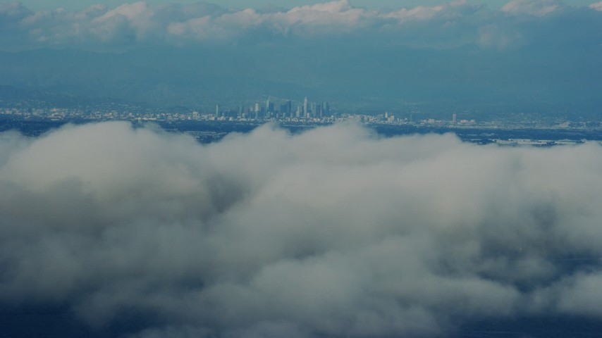 8K stock footage aerial video of Downtown Los Angeles seen from clouds off the coast of California Aerial Stock Footage | AX0160_027